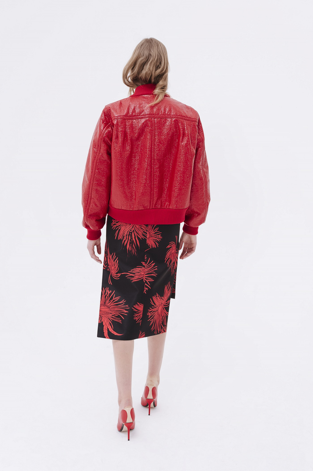 female model with red jacket and black&red flower printed pencil skirt